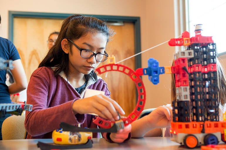 Middle school girl applying the scientific method to her work with Kid Spark ROK Blocks